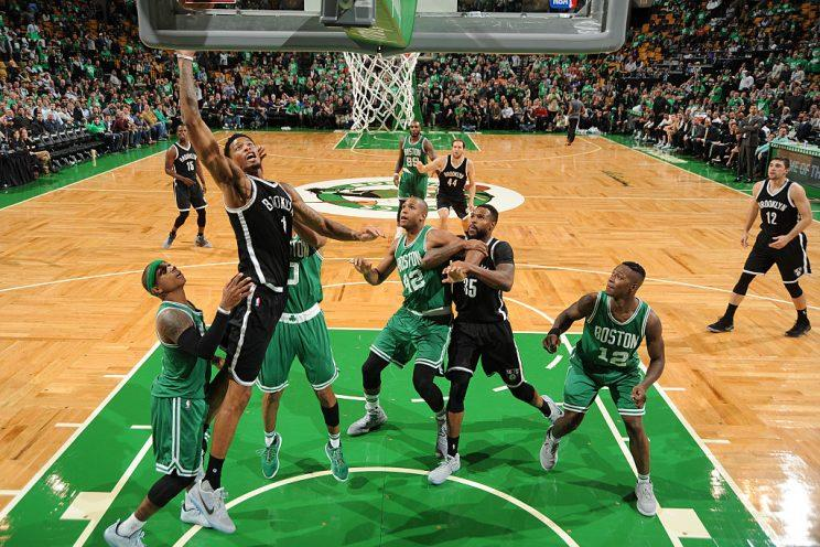 Nets forward Chris McCullough takes a leap against the Celtics. (Getty Images)