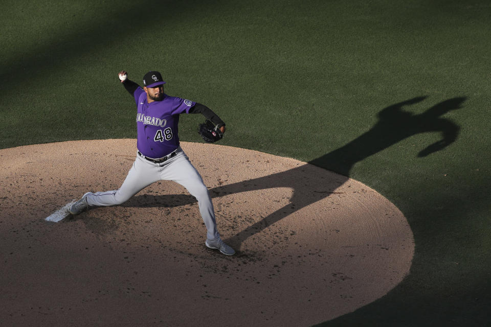 Colorado Rockies starting pitcher German Marquez works against the San Diego Padres during the second inning of a baseball game Saturday, July 31, 2021, in San Diego. (AP Photo/Derrick Tuskan)