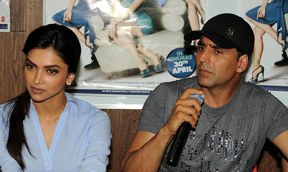Indian Bollywood actor Akshay Kumar (R) speaks as actress Deepika Padukone looks on during a press conference in Ahmedabad on April 28, 2010. The two are starring in the film 'Housefull' together with Jiah Khan and Ritesh Deshmukh.  AFP PHOTO/Sam PANTHAKY (Photo credit should read SAM PANTHAKY/AFP via Getty Images)
