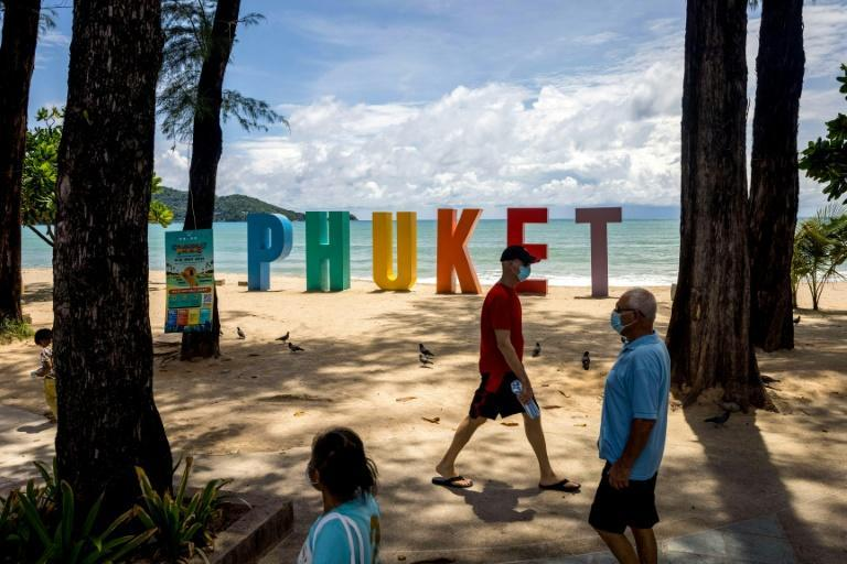 """Thailand says fully vaccinated travellers from any country can now visit Thailand using the Phuket """"sandbox"""" scheme (AFP/Jack TAYLOR)"""