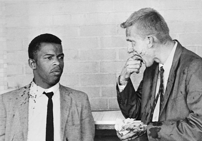 Two blood-splattered Freedom Riders, John Lewis (left) and James Zwerg (right) stand together after being attacked and beaten by pro-segregationists in Montgomery, Ala., on May 6, 1961. (Photo: Bettmann Archive/Getty Images)