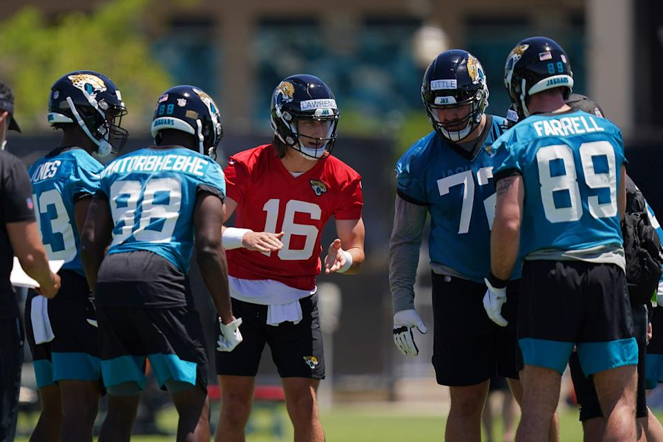 May 15, 2021; Jacksonville, Florida, USA; Jacksonville Jaguars quarterback Trevor Lawrence (16) calls a play in the huddle during rookie mini camp at TIAA Bank Field. Mandatory Credit: Jasen Vinlove-USA TODAY Sports