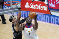 New Orleans Pelicans forward Zion Williamson (1) goes to the basket against Philadelphia 76ers forward Danny Green in the second half of an NBA basketball game in New Orleans, Friday, April 9, 2021. The Pelicans won 101-94. (AP Photo/Gerald Herbert)