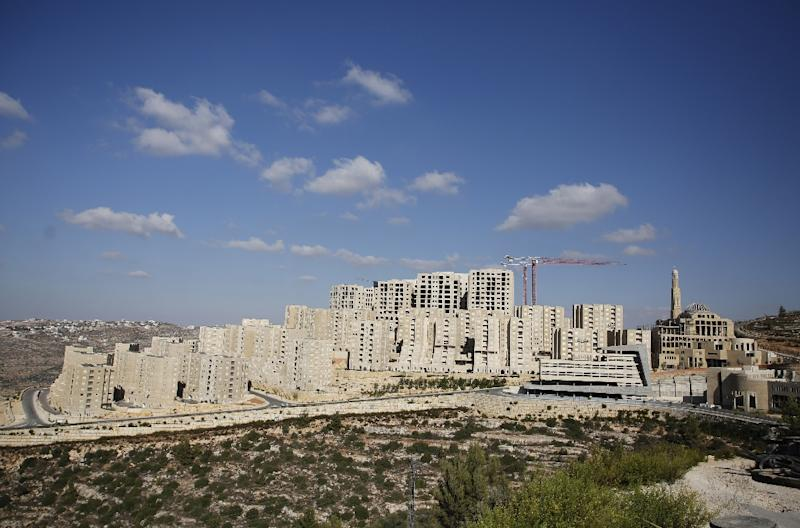 The developer has turned a vacant hillside of shrubs and sand into a city of gleaming residential streets and cafes (AFP Photo/ABBAS MOMANI)