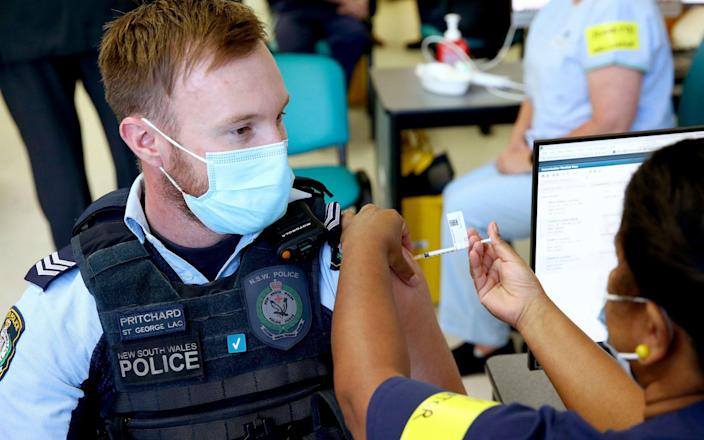 New South Wales Police officer Lachlan Pritchard receives the Pfizer vaccine - News Corp Australia Pool