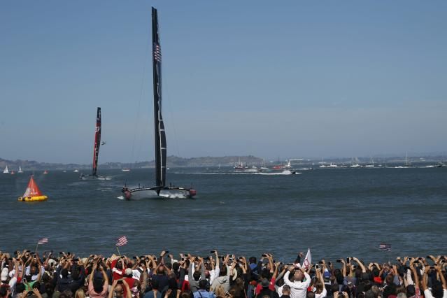 Oracle Team USA crosses the finish line ahead of Emirates Team New Zealand during Race 17 of the 34th America's Cup yacht sailing race in San Francisco, California September 24, 2013. REUTERS/Stephen Lam (UNITED STATES - Tags: SPORT YACHTING)