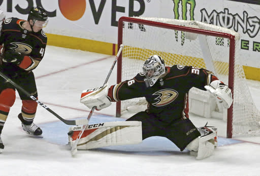 Anaheim Ducks goalie John Gibson (36) blocks a shot by the Washington Capitals during the second period of an NHL hockey game in Anaheim, Calif., Tuesday, March 6, 2018. (AP Photo/Reed Saxon)