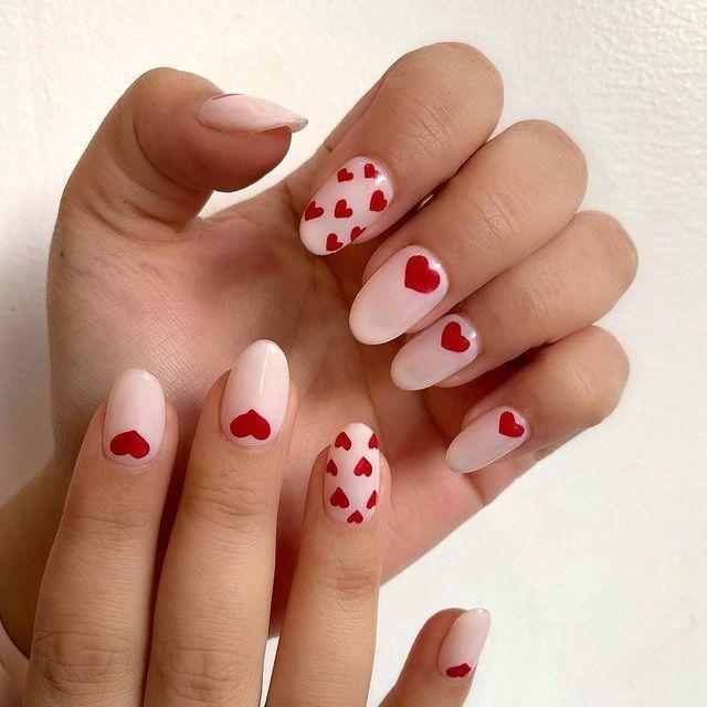 """<p>It's all in the details. You can't go wrong with tiny red heart decals on each nail. Spice it up by having one nail with multiple hearts for some added flair.</p><p><a href=""""https://www.instagram.com/p/B8RMqghH1KM/"""" rel=""""nofollow noopener"""" target=""""_blank"""" data-ylk=""""slk:See the original post on Instagram"""" class=""""link rapid-noclick-resp"""">See the original post on Instagram</a></p>"""