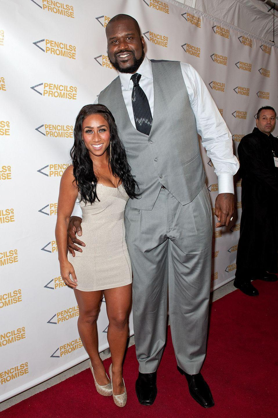 """<p><strong>Her: </strong>5'2"""" </p><p><strong>Him: </strong>7'1"""" </p><p><strong>Difference: </strong>23 inches</p>"""