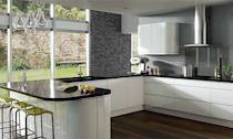 <b>Urban chic</b><br><br>This Integra Gloss White kitchen from Next is the ultimate in clean-line chic. The handless finger-pull doors keep the look streamlined, while reflective black worktops, glass splashblack and feature slate wall adds to the modern monochrome appeal. A group of glass pendants makes an interesting feature, as well as helping to keep the room light and bright.
