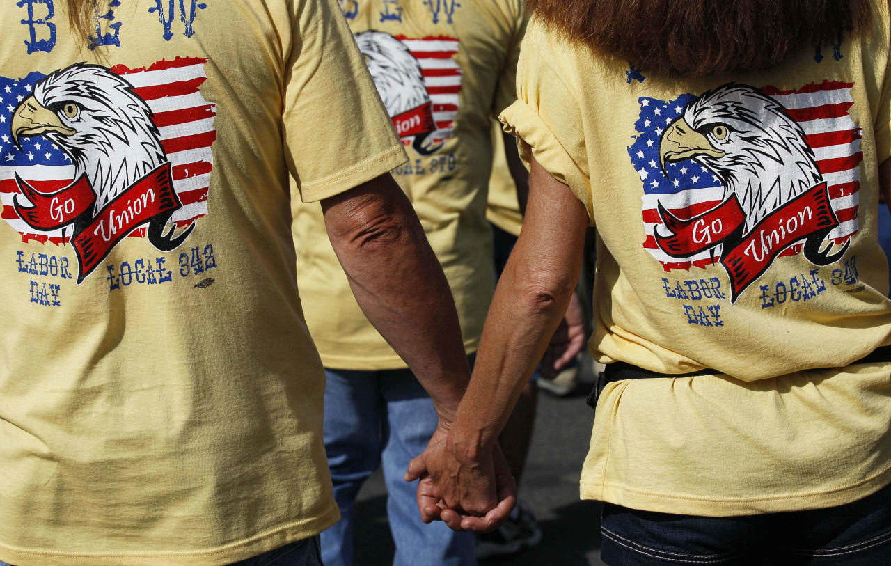 Demonstrators march in a Labor Day parade, Monday, Sept. 3, 2012, in Charlotte, N.C. Demonstrators are protesting before the start of the Democratic National Convention. (AP Photo/Gerry Broome)