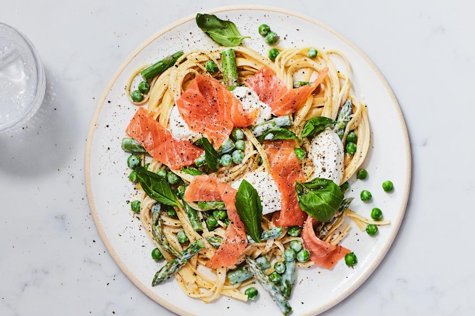 """This one-pot meal takes just 30 minutes to make, but it feels fancy enough for company. Sour cream and lemon zest combine for a sprightly sauce that complements packaged smoked salmon. <a href=""""https://www.epicurious.com/recipes/food/views/one-pot-spring-pasta-with-smoked-salmon?mbid=synd_yahoo_rss"""" rel=""""nofollow noopener"""" target=""""_blank"""" data-ylk=""""slk:See recipe."""" class=""""link rapid-noclick-resp"""">See recipe.</a>"""