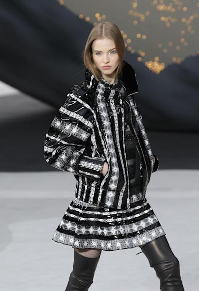 A model wears a creation by German fashion designer Karl Lagerfeld for Chanel's Fall/Winter 2013-2014 ready to wear collection, in Paris, Tuesday, March, 5, 2013. (AP Photo/Christophe Ena)