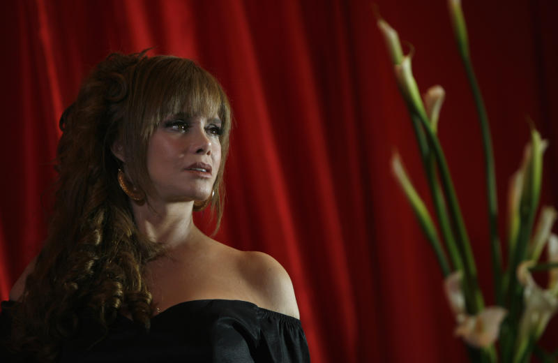 "Actress and singer Lucia Mendez, from Mexico, poses for photos during the presentation of her new album ""Canta un Homenaje a Juan Gabriel"" in Mexico City, Thursday Sept. 23, 2010. (AP Photo/Marco Ugarte)"