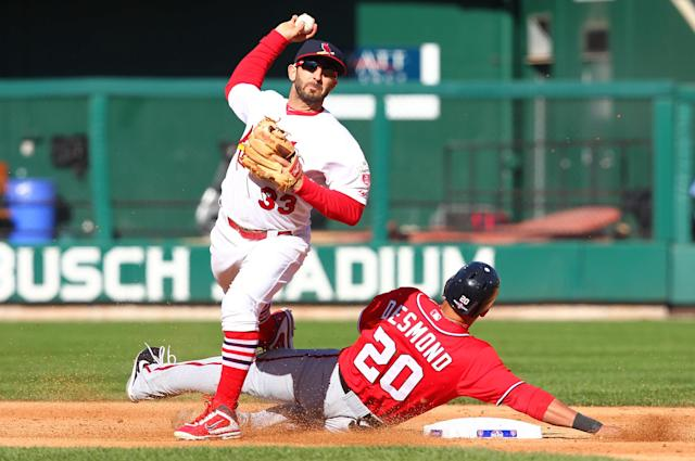 ST LOUIS, MO - OCTOBER 07: Ian Desmond #20 of the Washington Nationals slides into second to break up a double play as Daniel Descalso #33 of the St Louis Cardinals throws in the fourth inning during Game One of the National League Division Series at Busch Stadium on October 7, 2012 in St Louis, Missouri. (Photo by Dilip Vishwanat/Getty Images)