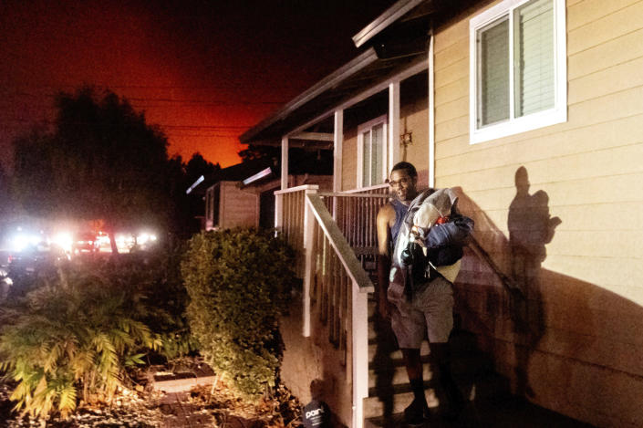 Image: Eddy Whitmore evacuates from his Santa Rosa, Calif., home as the Shady Fire approaches (Noah Berger / AP)