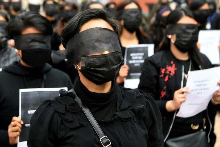 Several people wrapped black cloth around their eyes to symbolically protest the Nepalese government turning a blind eye to the increase of rape and murder cases