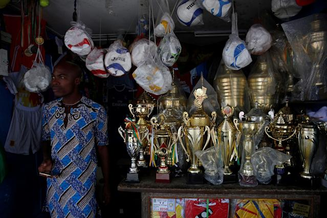 A vendor stands in his sporting goods shop in Abidjan, Ivory Coast May 18, 2018. REUTERS/Luc Gnago