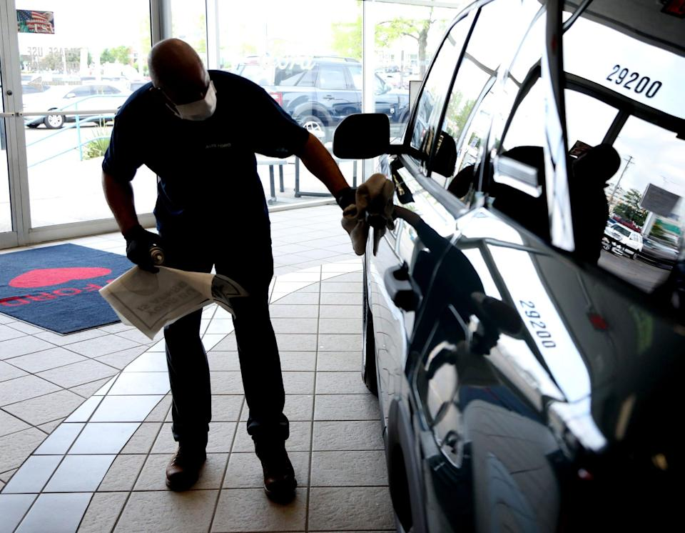 Avis Ford employee polishes up a 2021 Ford Bronco Sport in the showroom at the car dealership in Southfield, Michigan, on June 8, 2021.