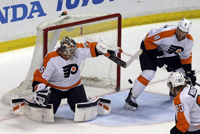 Philadelphia Flyers goalie Steve Mason (35), defenseman Niklas Grossmann (8), of Sweden, and right winger Jakub Voracek (41), of the Czech Republic, protect the goal against the Anaheim Ducks in the second period of an NHL hockey game in Anaheim, Calif., Thursday, Jan. 30, 2014. (AP Photo)