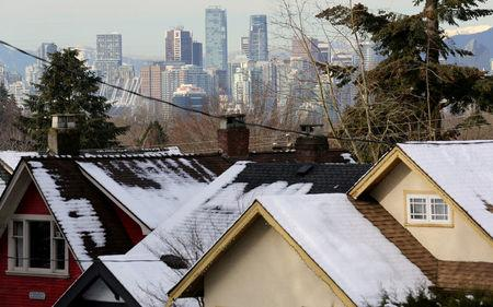 FILE PHOTO: Rooftops of houses and the downtown core in Vancouver