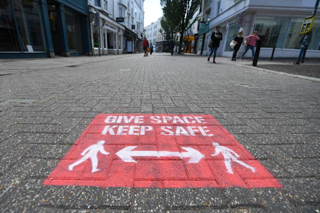 Social distancing reminders on display in Brighton. (Getty)