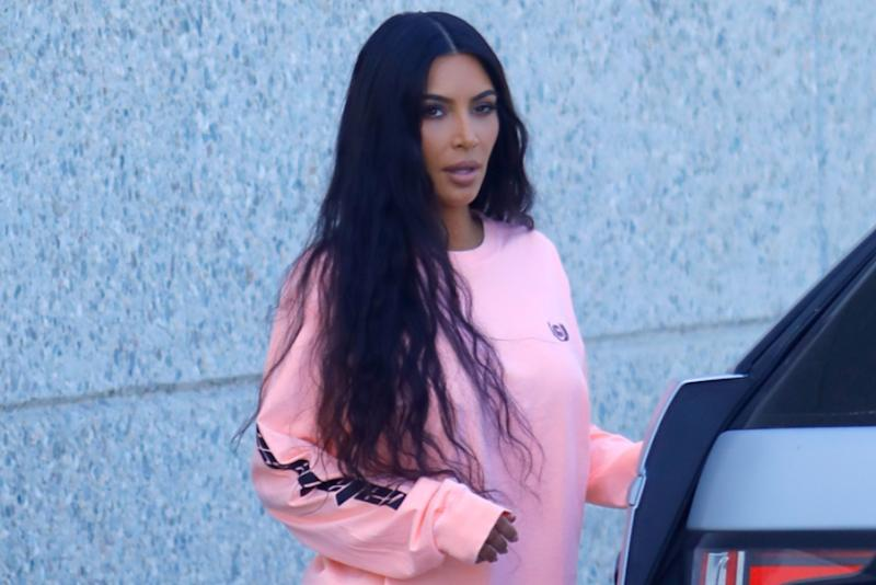 55807f3d0be38 ... Kim Kardashian was spotted modeling a neon and retro-inspired Yeezy  look complete with Desert Rat sneakers back home in Calabasas