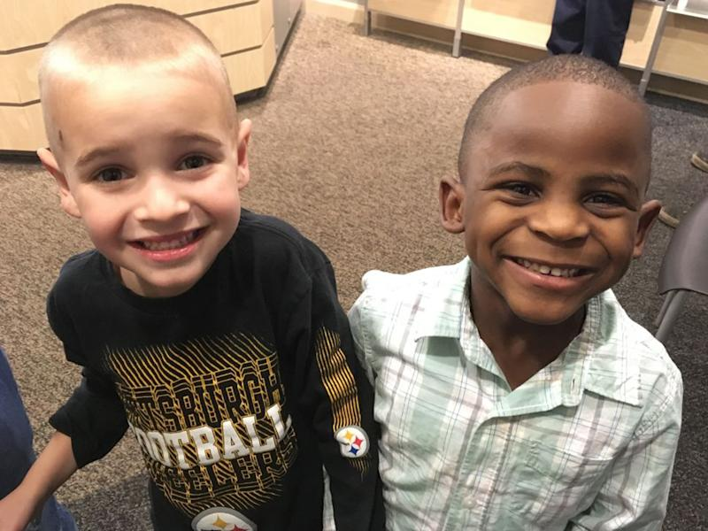 Jax, left, and Reddy smile after Jax got a haircut similar to his friend's: AP