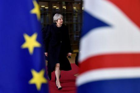 FILE PHOTO: British Prime Minister Theresa May arrives for the EU summit in Brussels, Belgium, December 14, 2017. To match Special Report BRITAIN-EU/MAY    REUTERS/Eric Vidal/File Photo