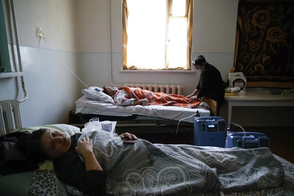 Coronavirus patients lie in an infectious diseases clinic in Stepanakert, in the separatist region of Nagorno-Karabakh, Tuesday, Oct. 20, 2020.Nagorno-Karabakh, which lies within Azerbaijan but has been under the control of ethnic Armenian forces since a war there ended in 1994, faces an outbreak of the coronavirus amid the largest outbreak of hostilities in more than a quarter-century. (AP Photo)