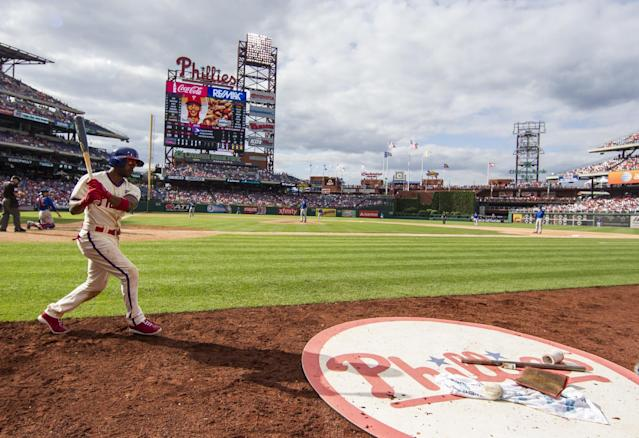 Philadelphia Phillies' Jimmy Rollins warms up before his at bat during the sixth inning of a baseball game against the Chicago Cubs, Saturday, June 14, 2014, in Philadelphia. The Phillies won 7-4. (AP Photo/Chris Szagola)