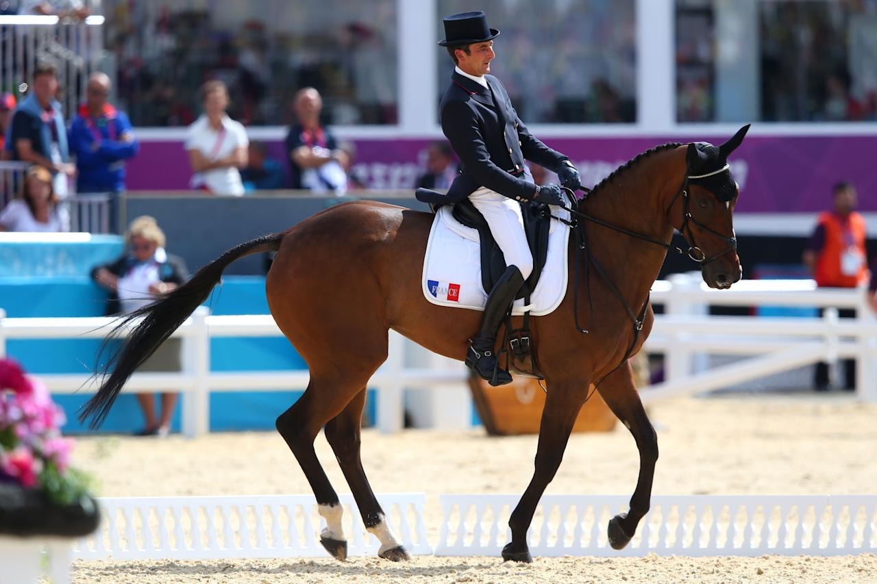 LONDON, ENGLAND - JULY 28:  Lionel Guyon of France riding Nemetis de Lalou competes in the Dressage Equestrian event on Day 1 of the London 2012 Olympic Games at Greenwich Park on July 28, 2012 in London, England.  (Photo by Alex Livesey/Getty Images)