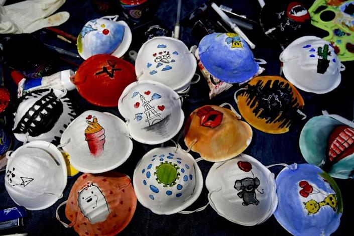 "N95 protective masks painted by Palestinian artists Samah Saed and Dorgam Krakeh for a COVID-19 awareness project. <span class=""copyright"">(Mohammed Abed / AFP/Getty Images)</span>"