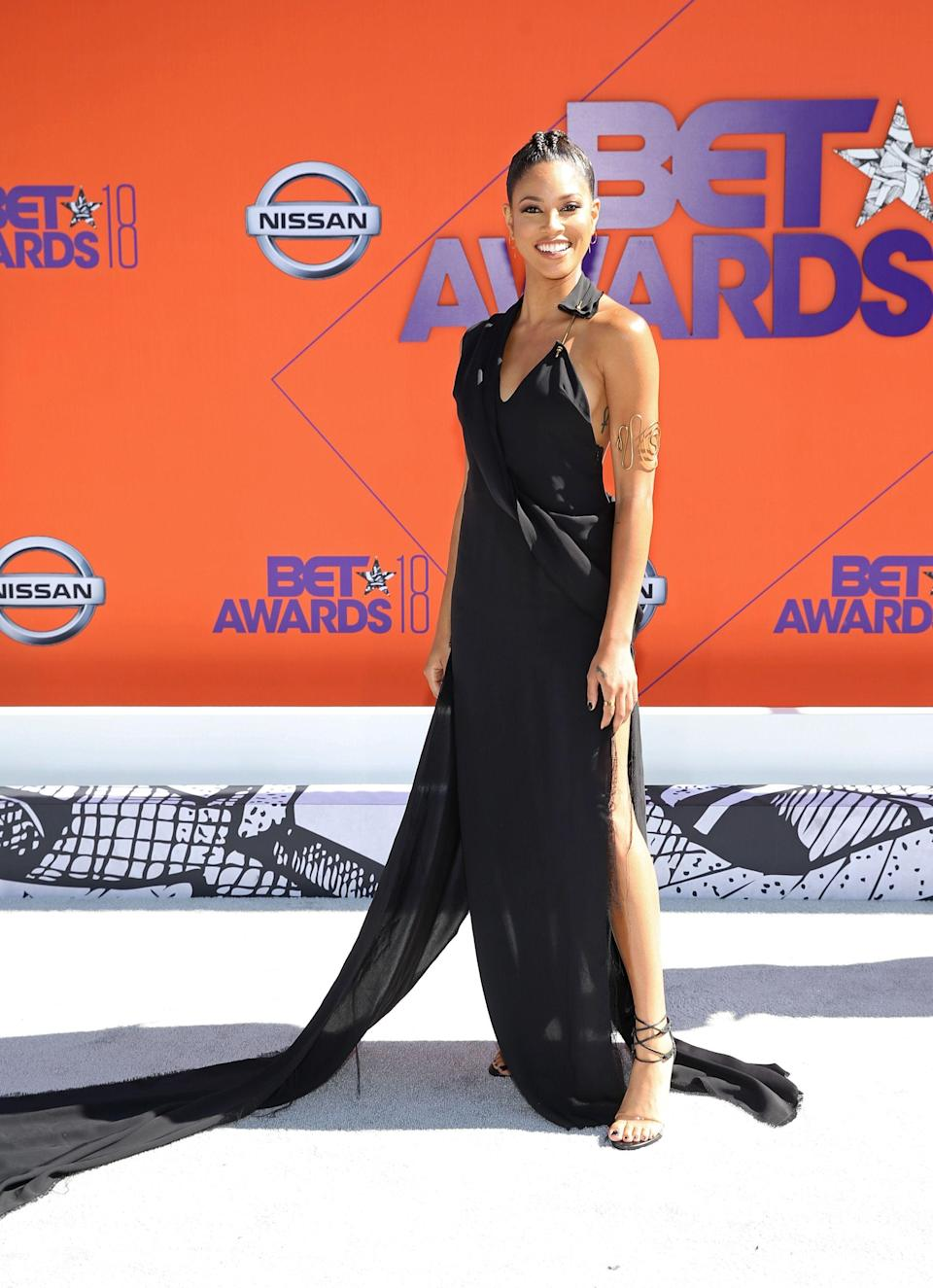 "<p>We're always a fan of a simple, black gown on the red carpet. Lex Scott Davis takes this one to the next level.</p><span class=""copyright"">Photo: Bennett Raglin/Getty Images.</span>"
