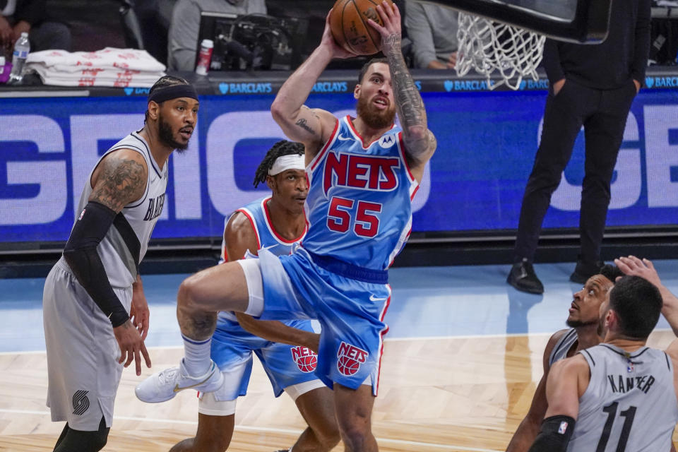 Brooklyn Nets guard Mike James (55) goes to the basket past Portland Trail Blazers forward Carmelo Anthony, left, and center Enes Kanter (11) during the first half of an NBA basketball game, Friday, April 30, 2021, in New York. (AP Photo/Mary Altaffer)