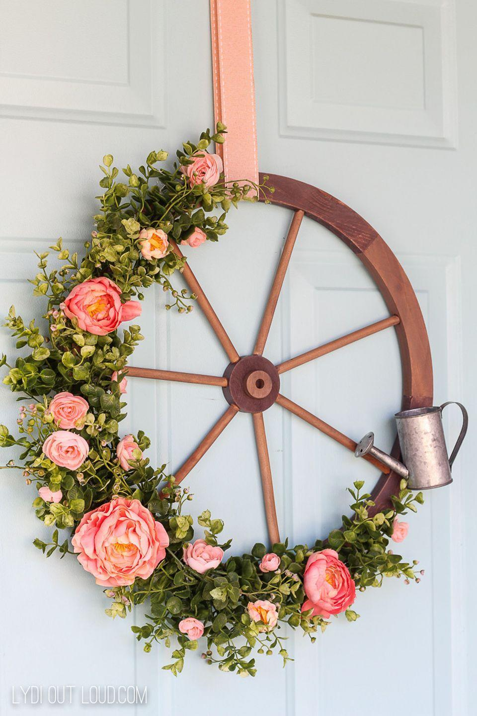 "<p>Add some farmhouse decor to your front door with this wagon wheel wreath. This blogger added a small watering can for extra oomph.</p><p><strong>Get the tutorial at <a href=""https://lydioutloud.com/wagon-wheel-farmhouse-style-wreath-tutorial/"" rel=""nofollow noopener"" target=""_blank"" data-ylk=""slk:Lydi Out Loud"" class=""link rapid-noclick-resp"">Lydi Out Loud</a>.</strong><br></p><p><a class=""link rapid-noclick-resp"" href=""https://www.amazon.com/Sculptures-Wooden-Decorative-Hanging-Inches/dp/B017S545C8/?tag=syn-yahoo-20&ascsubtag=%5Bartid%7C10050.g.4395%5Bsrc%7Cyahoo-us"" rel=""nofollow noopener"" target=""_blank"" data-ylk=""slk:SHOP WOODEN WAGON WHEELS"">SHOP WOODEN WAGON WHEELS</a> </p>"