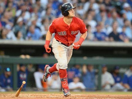Mar 25, 2019; Mesa, AZ, USA; Boston Red Sox left fielder Andrew Benintendi (16) runs to first after hitting a home run against the Chicago Cubs during the third inning at Sloan Park. Mandatory Credit: Joe Camporeale-USA TODAY Sports