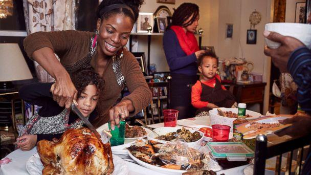 PHOTO: A family gathers around the dinner table. (Getty Images)