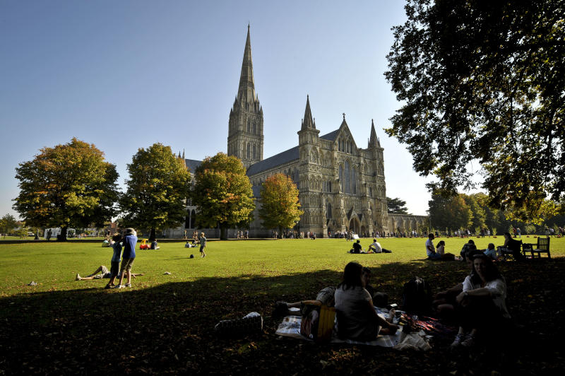 People enjoy the sunshine in Salisbury Cathedral Close, Salisbury, as the heatwave is set to continue well into next week in parts of Britain, following a weekend of record-breaking temperatures.