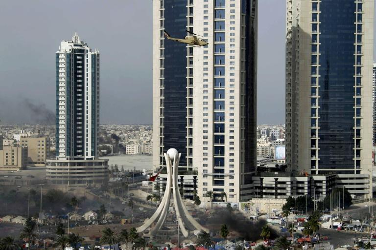 A Bahraini army attack helicopter hovers over Pearl Square in the capital Manama in this file photo taken on March 16, 2011