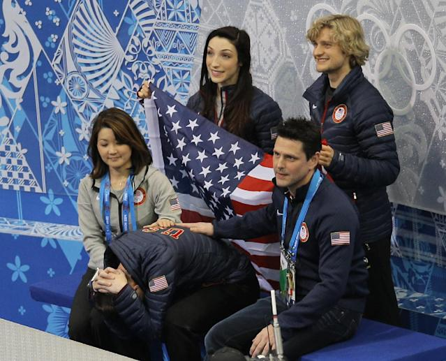 Jeremy Abbott of the United States, centre front, waits for his results after competing in the men's team short program figure skating competition at the Iceberg Skating Palace during the 2014 Winter Olympics, Thursday, Feb. 6, 2014, in Sochi, Russia