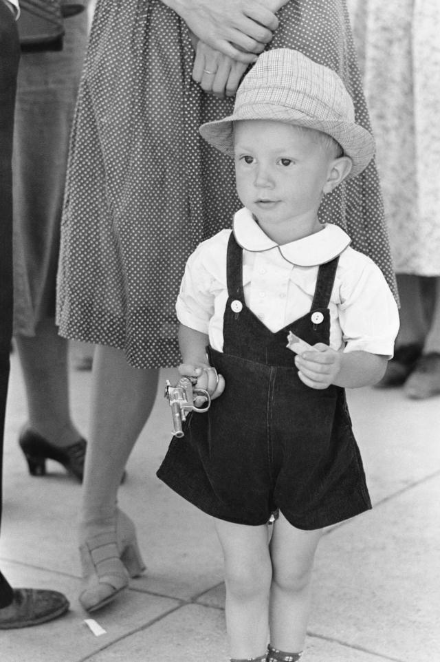 <p>A child attends an Independence Day celebration in Vale, Ore., 1941. (Photo; Corbis via Getty Images) </p>
