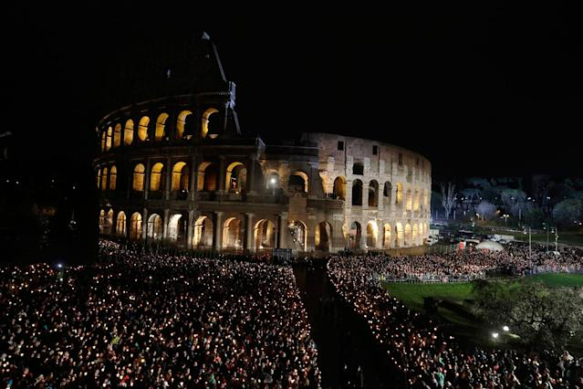 <p>People wait for Pope Francis' arrival for the Via Crucis (Way of the Cross) torchlight procession on Good Friday, a Christian holiday commemorating the crucifixion of Jesus Christ and his death at Calvary, in front of Rome's Colosseum, Friday, March 30, 2018. (Photo: Gregorio Borgia/AP) </p>