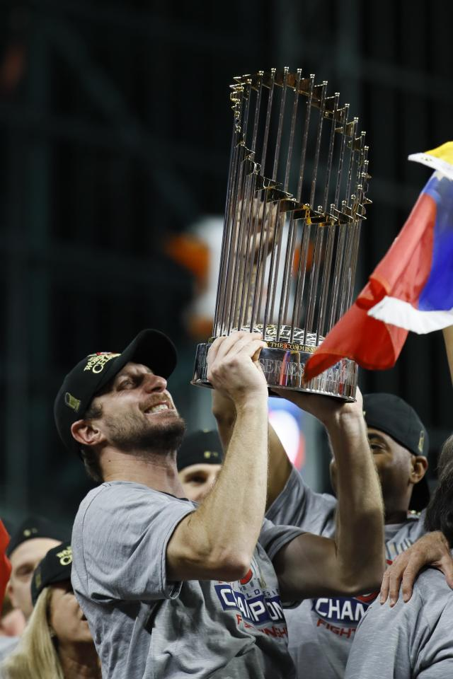 Washington Nationals' Max Scherzer celebrates after Game 7 of the baseball World Series against the Houston Astros Wednesday, Oct. 30, 2019, in Houston. The Nationals won 6-2 to win the series. (AP Photo/Matt Slocum)