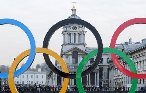 File photo shows giant Olympic Rings on a barge floating past the Old Naval College at Greenwich on the river Thames in London. Saudi Arabia, where sports events for women are banned, will allow females to compete in the Olympic Games for the first time
