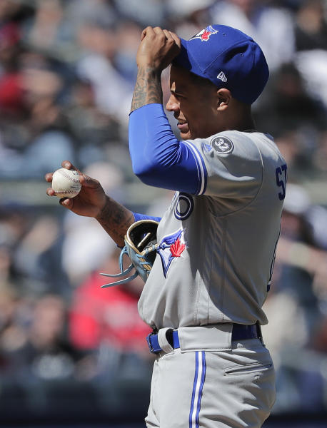 Toronto Blue Jays pitcher Marcus Stroman reacts after walking New York Yankees designated hitter Giancarlo Stanton during the sixth inning of a baseball game, Saturday, April 21, 2018, in New York. (AP Photo/Julie Jacobson)