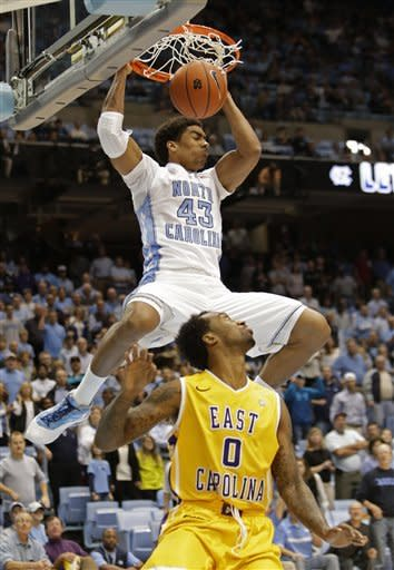 North Carolina's James Michael McAdoo (43) dunks over East Carolina's Miguel Paul (0) during the first half of an NCAA college basketball game in Chapel Hill, N.C., Saturday, Dec. 15, 2012. (AP Photo/Gerry Broome)