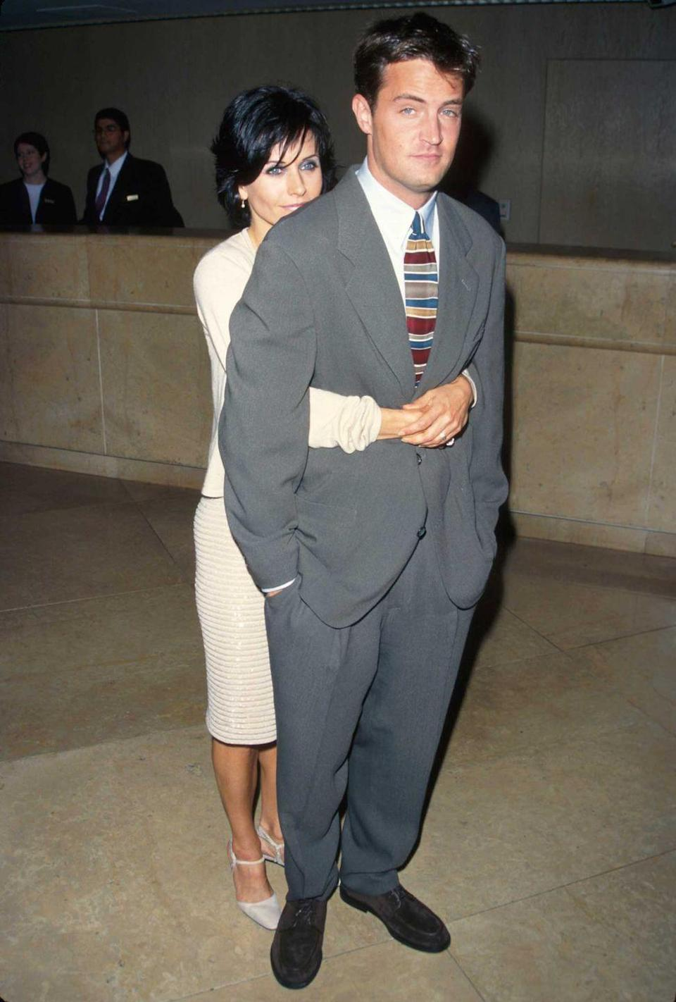 <p><em>Friends</em> actors Courteney Cox and Matthew Perry get close as real off-screen friends in 1997. </p>