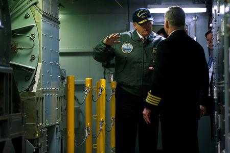 FILE PHOTO - Donald Trump tours the pre-commissioned U.S. Navy aircraft carrier Gerald R. Ford with McCormack in Newport News Virginia