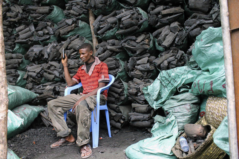 "In this photo of Tuesday Oct. 30, 2012 a Somali charcoal trader listen to his radio as he waits for customers at his charcoal store in Mogadishu, Somalia. Thousands of sacks of dark charcoal sit atop one another in Somalia's southern port city of Kismayo, an industry once worth some $25 million dollar a year to the al-Qaida-linked insurgents who controlled the region. The good news sitting in the idle pile of sacks is that al-Shabab militants can no longer fund their insurgency through the illegal export of the charcoal. Kenyan troops late last month invaded Kismayo and forced out the insurgents, putting a halt to the export of charcoal, a trade the U.N. banned earlier this year in an effort to cut militant profits. The loss of the charcoal trade ""will cut a major source of revenue and thus will have a detrimental effect on their operational capacity to carry out large scale attacks,"" Mohamed Sheikh Abdi, a Somali political analyst, said of al-Shabab. But the flip side to the charcoal problem is that residents who made their living from the trade no longer are making money, a potentially tricky issue for the Kenyan troops who now control the region. (AP Photo/Farah Abdi Warsameh)"